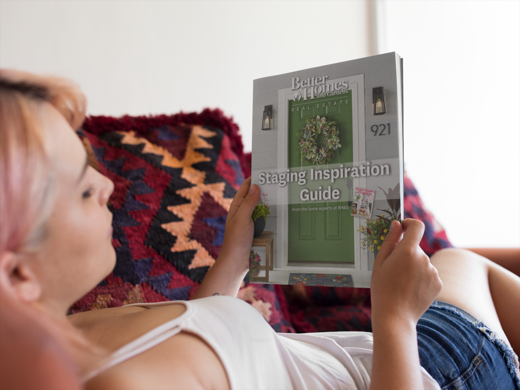 mockup-of-a-young-girl-with-pink-hair-looking-at-a-magazine-while-lying-down-in-her-sofa-a14368